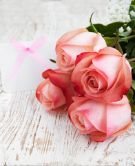 Blank card for your message and pink roses