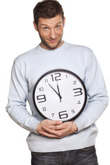 Handsome Young Male Holding A Time Clock