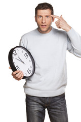 Handsome Young Male Holding A Time Clock And Pointing