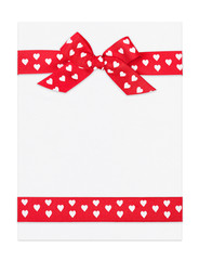 blank paper sheet with red bow