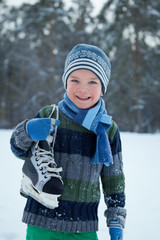 Portrait of boy with skates, winter