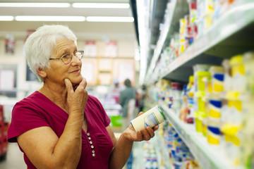 Senior woman at groceries store.