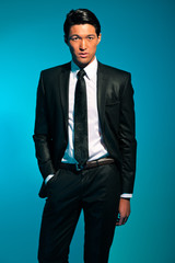 Handsome asian man in suit. Summer fashion. Studio shot.