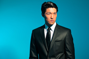 Handsome asian man in suit. Summer fashion. Studio shot.