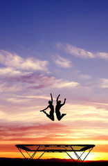 Wall Mural - silhouette of couple on trampoline