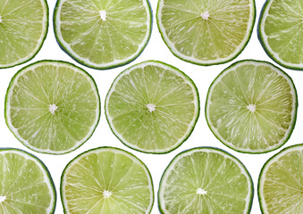 Food background - Sliced lime, isolated over white