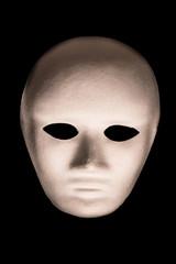 White Full Face Mask on Isolated Black Background