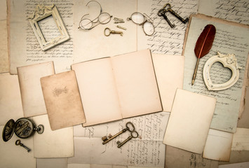 open book, vintage accessories, old letters and documents