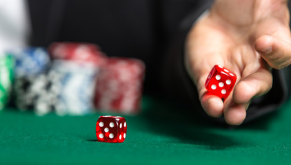 Player throws dices on the poker table