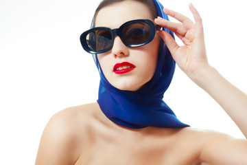 woman in glasses and headscarf