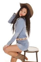 Asian woman denim hat sit
