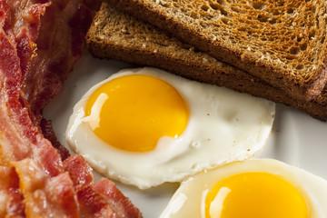 Organic Sunnyside up Egg with toast and bacon