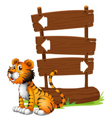 A tiger beside a wooden signboard