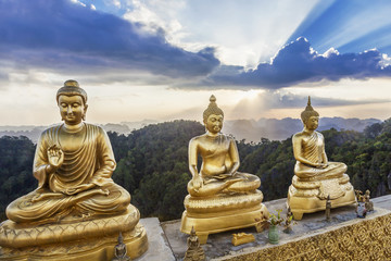 Buddha statues with beauty sunset background