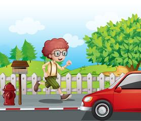A boy running along the road