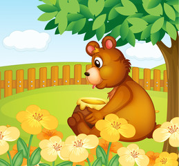 Canvas Prints Bears A bear sitting in a beautiful garden