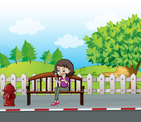 A smiling girl sitting on a bench