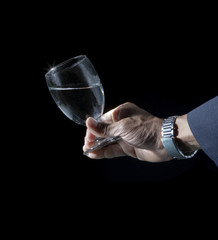 hand and wine glass on black