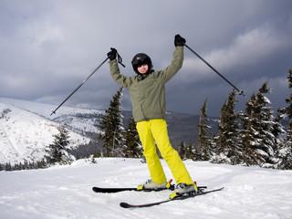 Teenage boy skiing