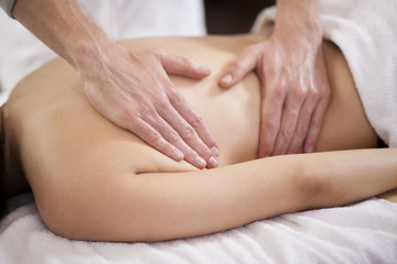 Closeup of a woman getting a massage at a health and beauty spa