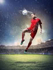 Fotobehang voetbal football player striking the ball