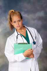Healthcare worker in white lab coat and clip board