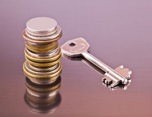 Stack of coins and key