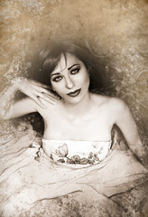 Beautiful Woman in Luxury dress. Sepia Toned.Vintage Style