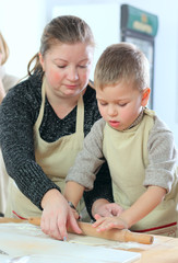 Little boy with his mother cooking