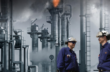 oil and gas refinery with workers, safety flames burning