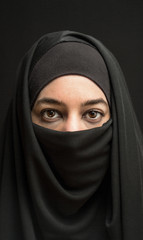 woman in burka over dark background