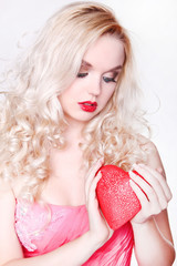 Sexy blonde girl with big red heart in love. Valentine Day theme