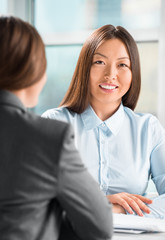 Portrait of two business women meeting at office