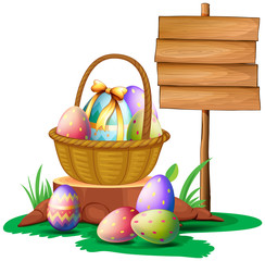 Easter eggs near a wooden signboard