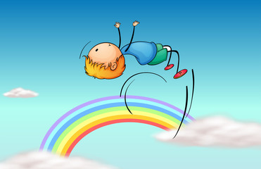 Poster Regenboog A boy jumping in the sky and a rainbow