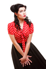 woman pinup makeup hairstyle posing in studio