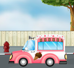 A pink ice cream bus at the road