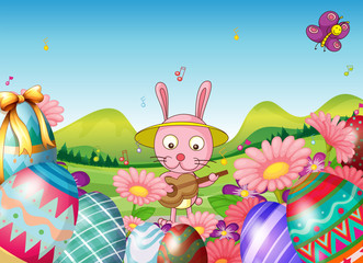 A bunny with a guitar and the easter eggs in the garden