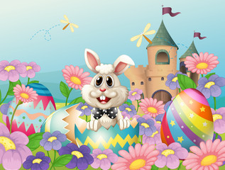 An easter bunny in the garden near the castle