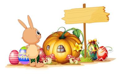 A rabbit, easter eggs, a pumpkin and an empty signboard