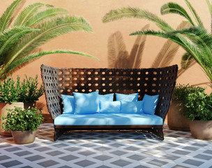 Romantic aged stucco patio with outdoor sofa and plants
