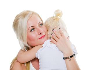 Mum calms a small daughter