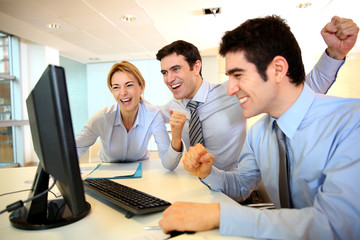 Cheerful sart-up team shouting in office