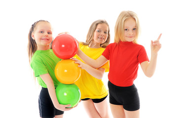 Girls with colored balls imitating traffic lights