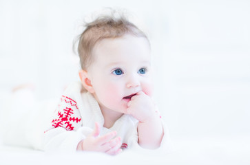 Happy baby in red and white nordic sweater