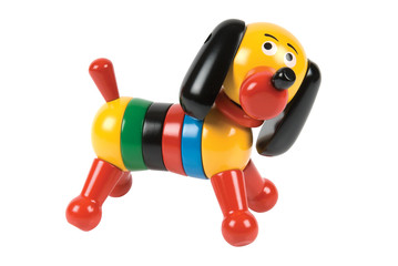 Wooden toy dog on a white background. Clipping path included.