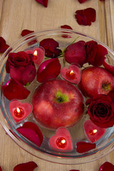 Valentine apple witn candles and rose petals