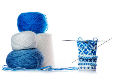 Balls of yarn and mittens knitted wool are