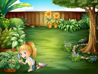 A girl studying the plants in the garden
