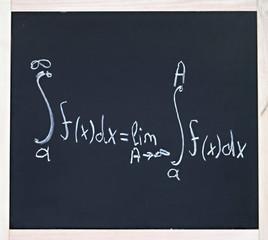 Advanced mathematics formula written in chalk on blackboard